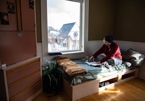 Ashley Acre, 30, reads in her room at City Rescue, a shelter for the homeless, in Saginaw.
